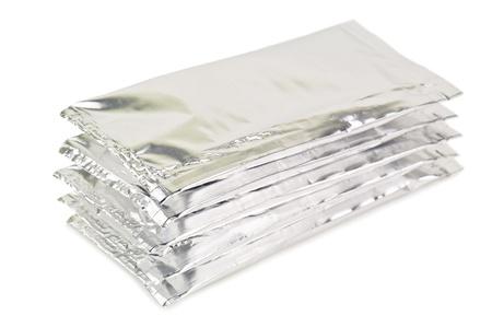 silver aluminium packagings on white photo