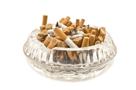 full ashtray on white background photo