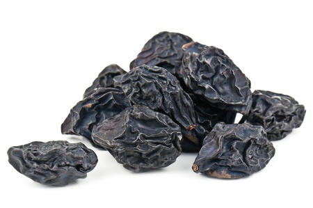 heap of prunes on white photo