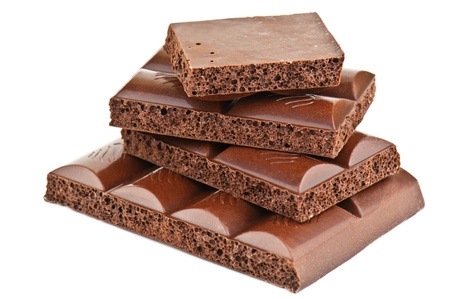 porous chocolate bars on white photo