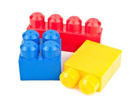 multi colors: plastic toy blocks on white