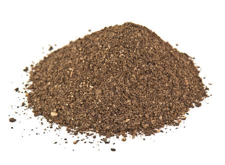 black pepper: heap of pepper powder on white Stock Photo