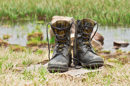 muddy clothes: dirty hiking  military  boots in the photo