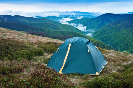 wet tent in the evening mountains photo