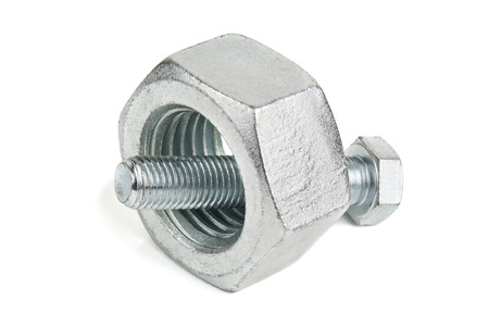 small bolt and too big nut on white  Stock Photo