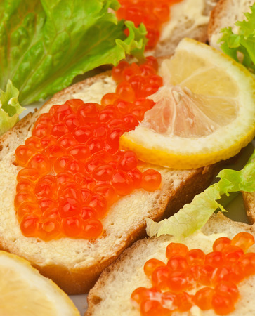 red caviar and lemon on bread photo