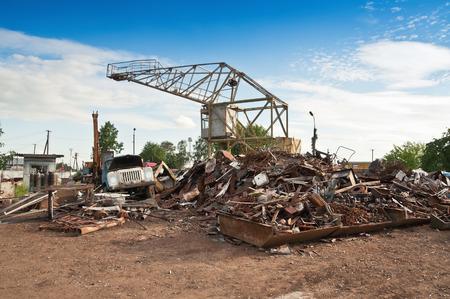 crane at the metal dump (scrap) photo