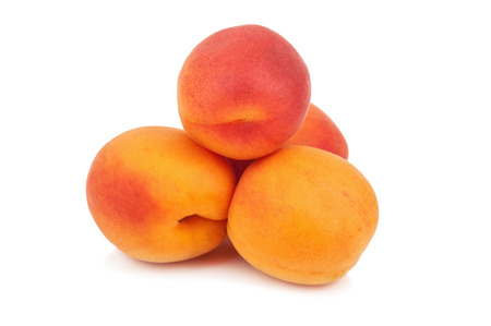 heap: heap of sweet and juicy apricots on white background