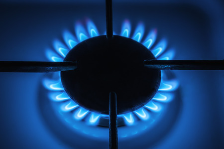 blue flames: Natural gas stove heating with blue flames.