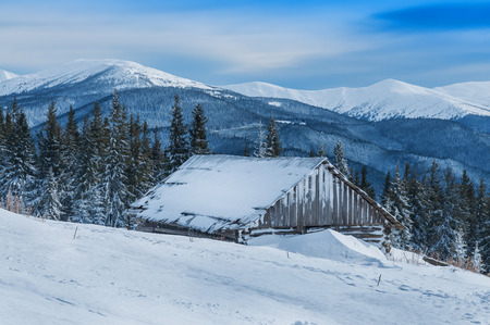 abandoned house (cabin) in winter mountain