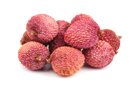 lychee juice: heap of ripe sweet lychees on white background Stock Photo