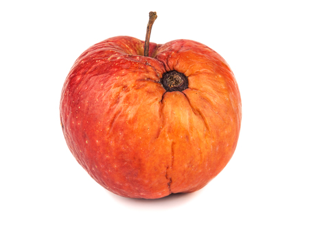 bad apple: apple with rotten spot on white background