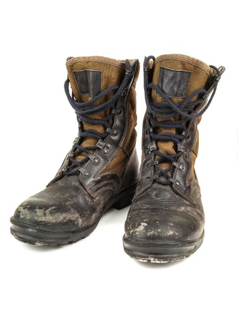 hillwalking: old black military boots on white background