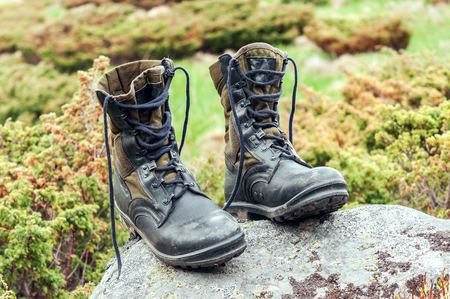 military boots: black hiking (military) boots on the stone Stock Photo