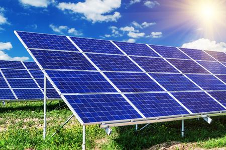 breaking new ground: solar panels under blue sky and sunlight