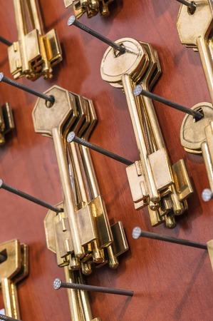 passkey: golden key blanks on nails Stock Photo