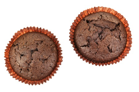 paper basket: two delicious muffins in paper basket on white background