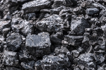calorific: black coal as a texture. a place where coal is stored for selling. Stock Photo