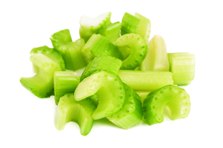 heap of chopped raw celery on white background