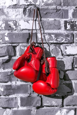 red boxing gloves on the wall in monochrome Stock Photo