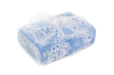 glycerin soap: foam on blue soap on white background