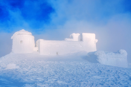abandoned snow-covered observatory on the mountain Pip Ivan, called White Elephant in the Carpathian mountains.Winter time