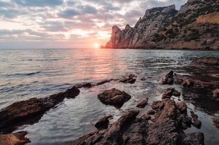 beautiful sunset and rocky sea beach