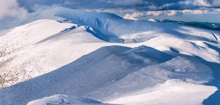 panorama of snow-covered winter mountains