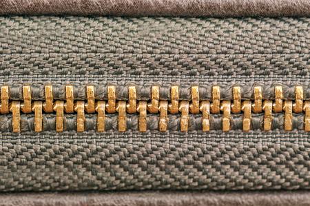 yellow metal zipper as a texture