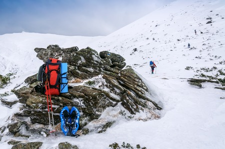 backpack, snowshoe in high winter mountain