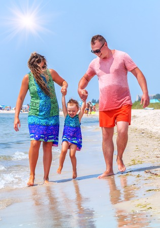 happy young family on the beach Stock Photo