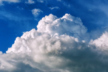 fluffy thundercloud and blue sky. Texture