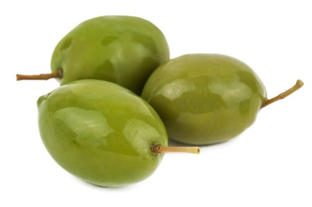 three ripe green olives on white background