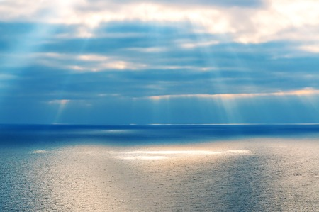 clouds with sunbeam (sunlight) and sea