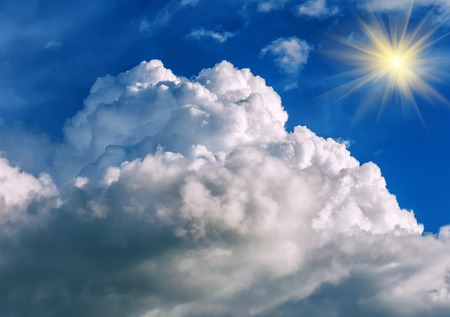 thundercloud: fluffy thundercloud on blue sky and sunlight Stock Photo