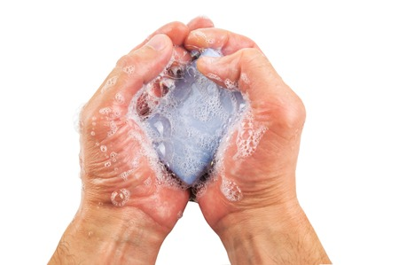 lavarse las manos: blue soap with foam in the hands isolated on white Foto de archivo