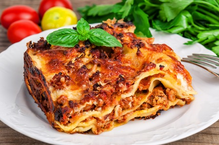 delicious italian lasagna with basil leaves Stock Photo