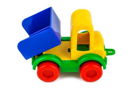 camión de juguete de plástico sobre fondo blanco Foto de archivo
