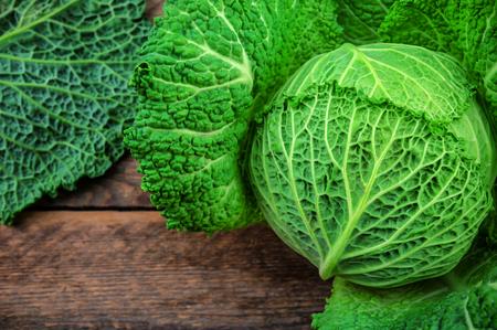 savoy: raw savoy cabbage on wooden background