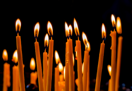 wax candles in church on black background Stock Photo