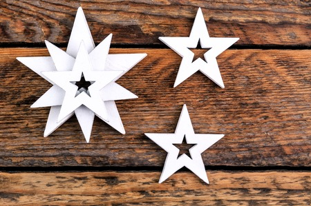 white stars on wooden background
