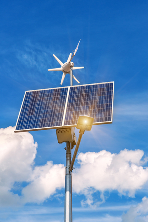 solar panel and windmill under blue sky