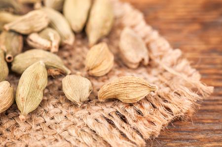 scented cardamom on burlap napkin Stock Photo