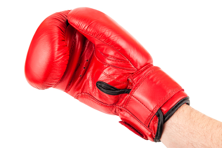 red boxing glove on the hand isolated on white