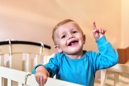 happy and smiling little boy (child) pointing finger Stock Photo