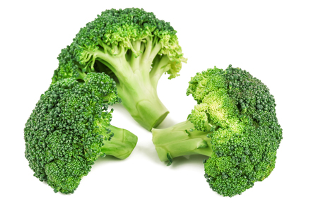 three green, raw broccoli isolated on white