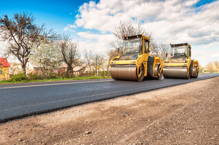 two working road rollers making new road