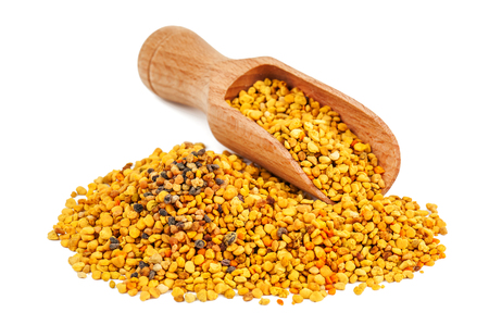 Bee pollen grains on a white background. Healthy natural medicine for influenza. Фото со стока