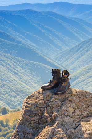 black hiking (jungle) boots on the rock Stock Photo