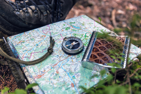 tourist compass and flask on the map Archivio Fotografico